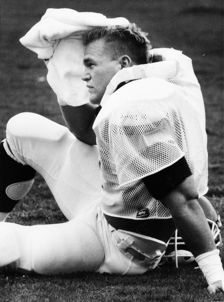 Former OU linebacker Brian Bosworth takes a breather during spring football drills in April 1986. PHOTO BY JIM ARGO, The Oklahoman Archive