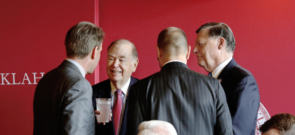 Photo -  OU President David Boren, second from left, smiles while visiting with Dr. Ned Sharpless, director of the National Cancer Institute, on Wednesday. With Boren and Sharpless are, from right, U.S. Rep. Tom Cole, R-Moore, and Robert Mannel. [Photo by Jim Beckel, The Oklahoman]