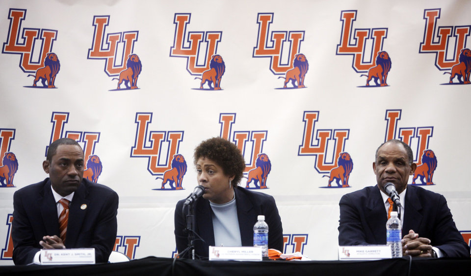Photo - Langston University President Kent Smith, Jr. (left), Women's basketball great Cheryl Miller (center), and Langston athletic director Mike Garrett (right) take questions from media and fans at a press conference where Cheryl Miller was introduced as the head coach of Langston's women's basketball program on Tuesday, April 29, 2014 Photo by KT King, The Oklahoman
