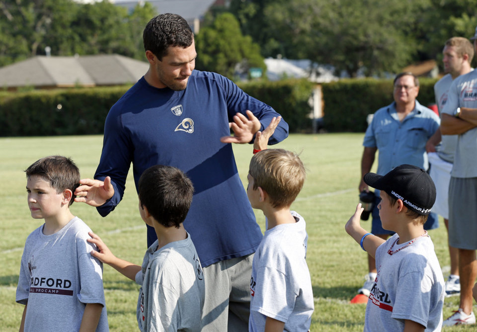 Sam Bradford works with campers during his football camp on the campus of the University of Oklahoma on Tuesday, July 10, 2012, in Norman, Okla. Photo by Steve Sisney, The Oklahoman STEVE SISNEY
