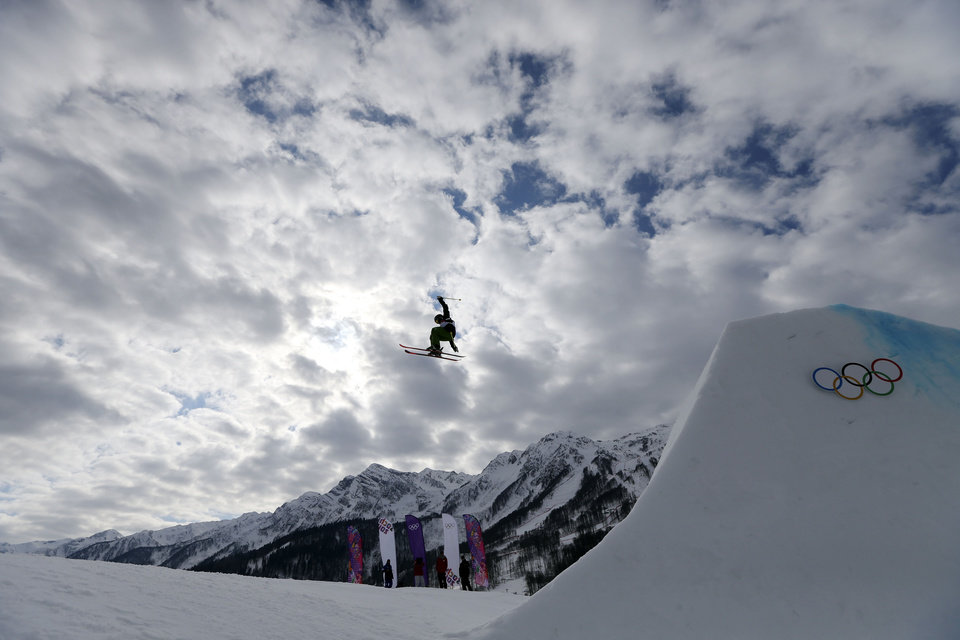 Photo - A competitor takes a jump during freestyle skiing slopestyle training at the 2014 Winter Olympics, Monday, Feb. 10, 2014, in Krasnaya Polyana, Russia. (AP Photo/Sergei Grits)