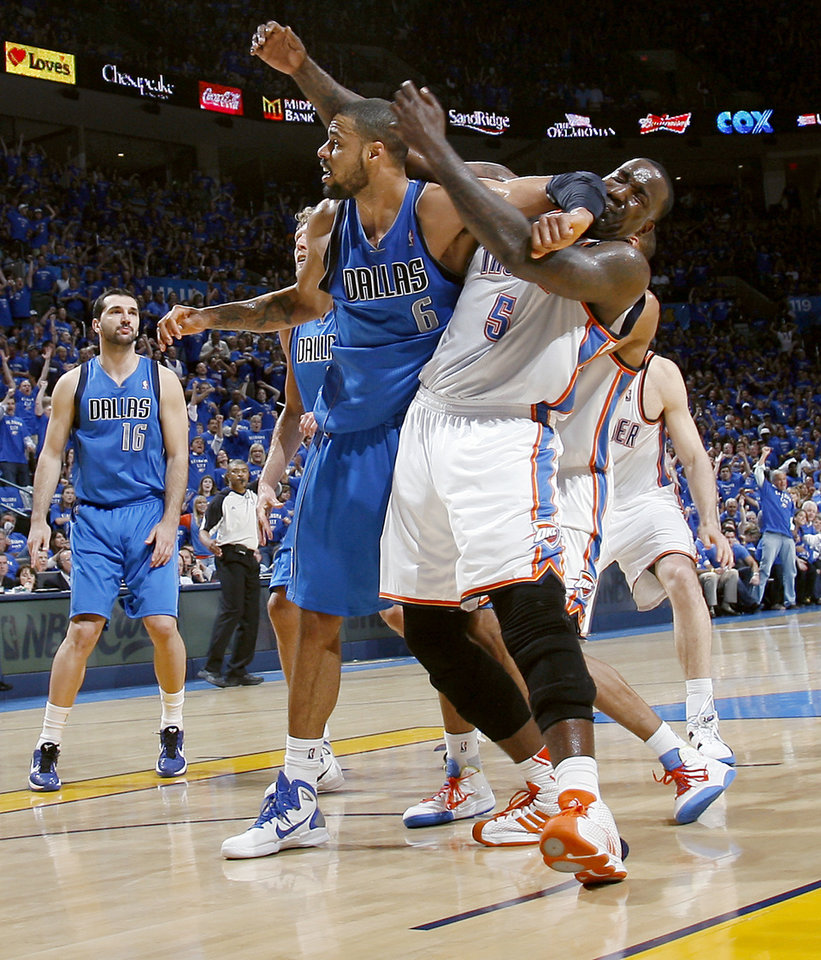 Photo - Tyson Chandler (6) of Dallas, gets an elbow in Kendrick Perkins' face and is called for a technical foul during game 4 of the Western Conference Finals in the NBA basketball playoffs between the Dallas Mavericks and the Oklahoma City Thunder at the Oklahoma City Arena in downtown Oklahoma City, Monday, May 23, 2011. The Thunder lost game 3 to the Mavericks 112-105. Photo by John Clanton, The Oklahoman