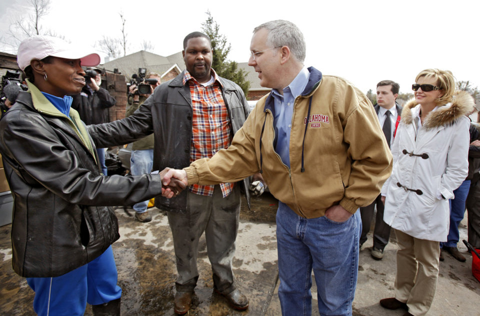 Gov. Brad Henry and his wife Kim visit with Sammetra Christmon and her husband Nathan as Henry tours the damage to homes in the Oakwood East Royale addition that were destroyed by wildfires on Friday, April 10, 2009, in Midwest City, Okla.  Photo by Chris Landsberger, The Oklahoman