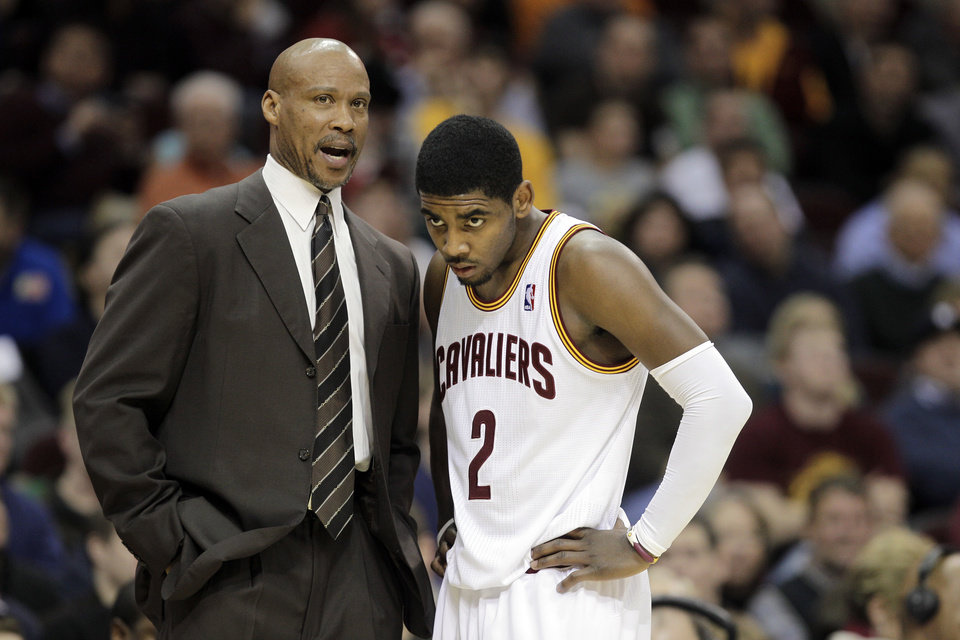 Photo -   FILE - In this Feb. 21, 2012 file photo, Cleveland Cavaliers head coach Byron Scott talks with Kyrie Irving (2) during an NBA basketball game against the Detroit Pistons in Cleveland. Scott understands the reigning Rookie of the Year and his potential better than anyone. He and the kid point guard have a close bond, one that has grown tighter and reminds Scott of the relationship he formed with Chris Paul when the two were in New Orleans. (AP Photo/Mark Duncan, File)