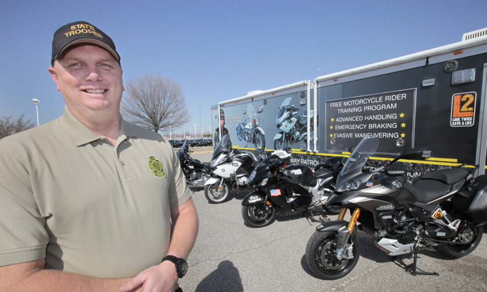 Oklahoma Highway Patrol Trooper Clint Riddle with the advanced motorcycle training equipment used to teach riders statewide. Photo by David McDaniel, The Oklahoman