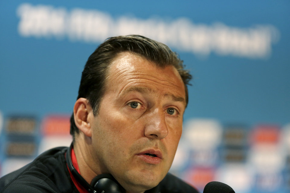 Photo - Belgium head coach Marc Wilmots speaks during a press conference at the Mineirao Stadium in Belo Horizonte, Brazil, Monday, June 16, 2014. Belgium will play in group H of the Brazil 2014 soccer World Cup.  (AP Photo/Bruno Magalhaes)