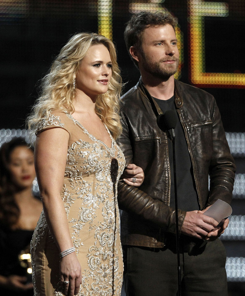 Photo - Tishomingo resident Miranda Lambert, left, and Dierks Bentley present an award onstage during the 54th annual Grammy Awards on Sunday, Feb. 12, 2012 in Los Angeles. The tourmates will perform together Sunday night on the 2013 Grammys.  AP Photo  Matt Sayles - AP