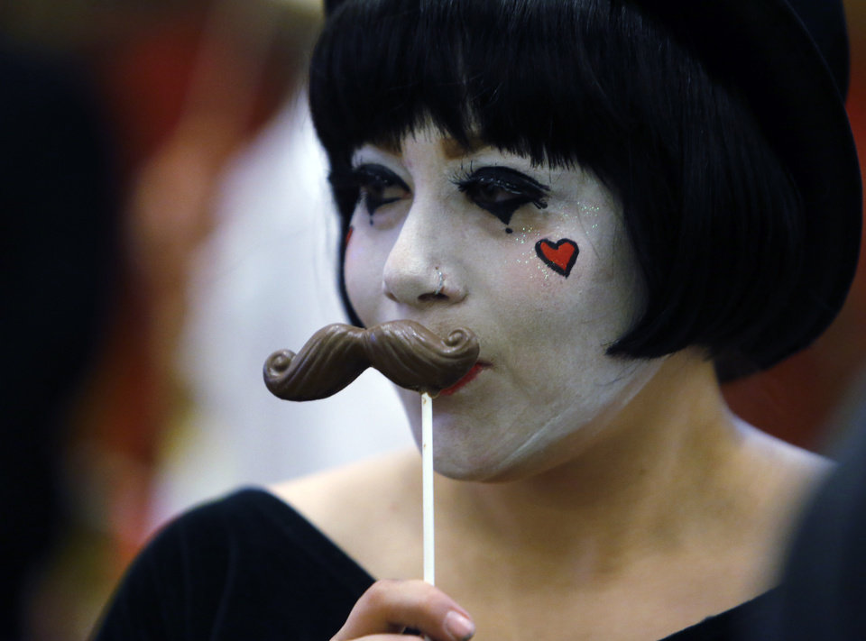 Sara Hughes sports a chocolate moustach as she works at the Abbey Road Catering booth during at the Firehouse Art Center's annual Chocolate Festival on Saturday, Feb. 2, 2013 in Norman, Okla.  Photo by Steve Sisney, The Oklahoman