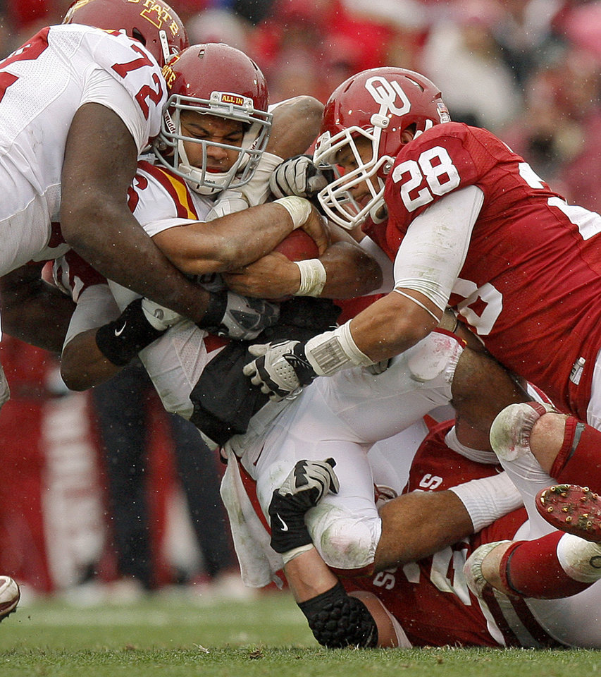 Photo - Oklahoma's Travis Lewis (28) and Tom Wort (21) bring down Iowa State's Jared Barnett (16) during a college football game between the University of Oklahoma Sooners (OU) and the Iowa State University Cyclones (ISU) at Gaylord Family-Oklahoma Memorial Stadium in Norman, Okla., Saturday, Nov. 26, 2011. Photo by Bryan Terry, The Oklahoman