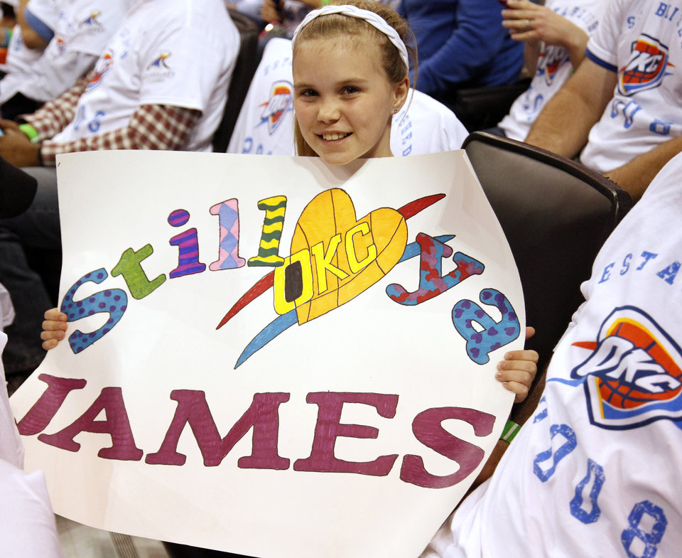 Photo - Thunder fan Caroline Russell, 11, shows her sign for James Harden during Game 2 in the first round of the NBA playoffs between the Oklahoma City Thunder and the Houston Rockets at Chesapeake Energy Arena in Oklahoma City, Wednesday, April 24, 2013. Oklahoma City won, 105-102. Photo by Nate Billings, The Oklahoman
