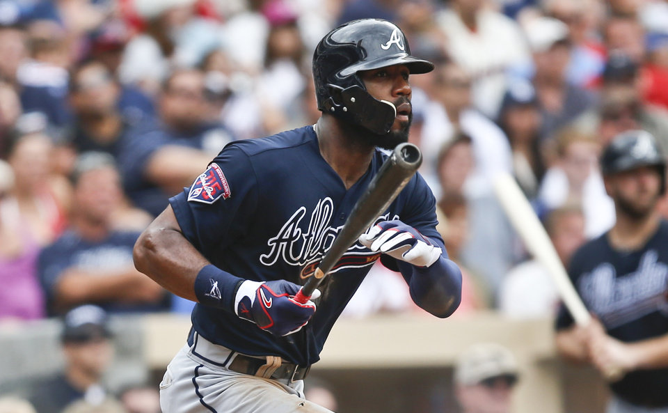 Photo - Atlanta Braves' Jason Heyward watches his line drive down the right field line stay fair for an RBI triple against the San Diego Padres in the seventh inning of a baseball game Sunday, Aug. 3, 2014, in San Diego.  (AP Photo/Lenny Ignelzi)