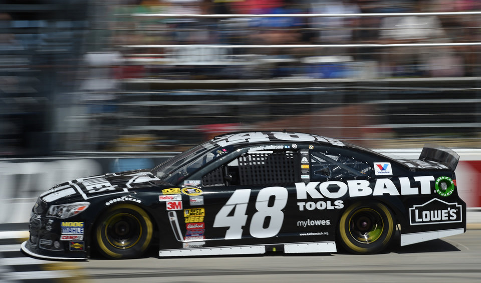Photo - Jimmie Johnson drives during the NASCAR Sprint Cup series auto race, Sunday, June 1, 2014, at Dover International Speedway in Dover, Del. (AP Photo/Molly Riley)