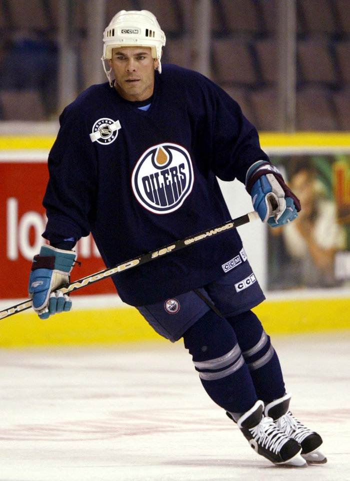 Photo -   FILE - In this Nov. 19, 2003, file photo, Edmonton Oilers' Adam Oates skates during NHL hockey practice in Edmonton, Alberta. Oates was elected to the Hockey Hall of Fame on Tuesday, June 26, 2012, joining Mats Sundin, Pavel Bure and Joe Sakic as the newest class of inductees. (AP Photo/The Canadian Press, Adrian Wyld, File)
