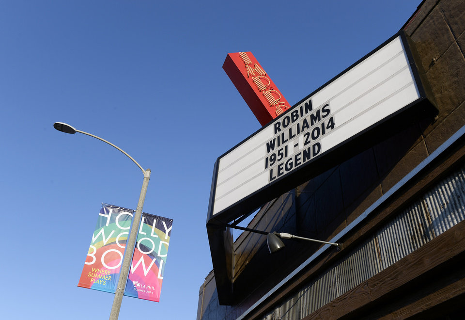 Photo - The marquee of the Improv is seen in memory of actor/comedian Robin Williams in the Hollywood district of Los Angeles Monday, Aug. 11, 2014. Williams, the Academy Award winner and comic supernova whose explosions of pop culture riffs and impressions dazzled audiences for decades and made him a gleamy-eyed laureate for the Information Age, died Monday in an apparent suicide at his San Francisco Bay area home. He was 63. (AP Photo/Kevork Djansezian)