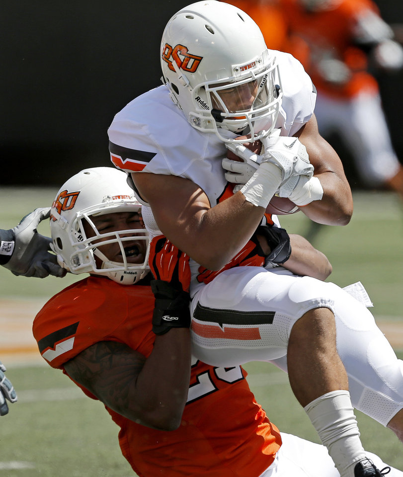 Oklahoma State\'s Corey Bennett is brought down by Joe Mitchell during OSU\'s spring football game at Boone Pickens Stadium in Stillwater, Okla., Sat., April 20, 2013. Photo by Bryan Terry, The Oklahoman