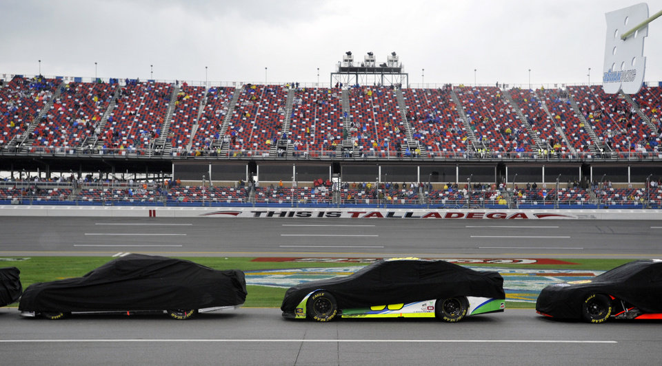Photo - Cars are covered during a rain delay in the NASCAR Sprint Cup Series Aaron's 499 auto race at Talladega Superspeedway in Talladega, Ala., Sunday, May 5, 2013. (AP Photo/Rainier Ehrhardt)
