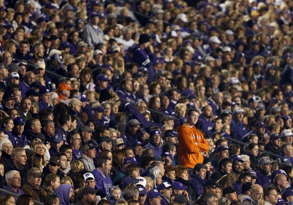 Photo - An Oklahoma State fan looks on from the stands during the college football game between the Oklahoma State University Cowboys (OSU) and the Kansas State University Wildcats (KSU) at Bill Snyder Family Football Stadium on Saturday, Nov. 1, 2012, in Manhattan, Kan. Photo by Chris Landsberger, The Oklahoman