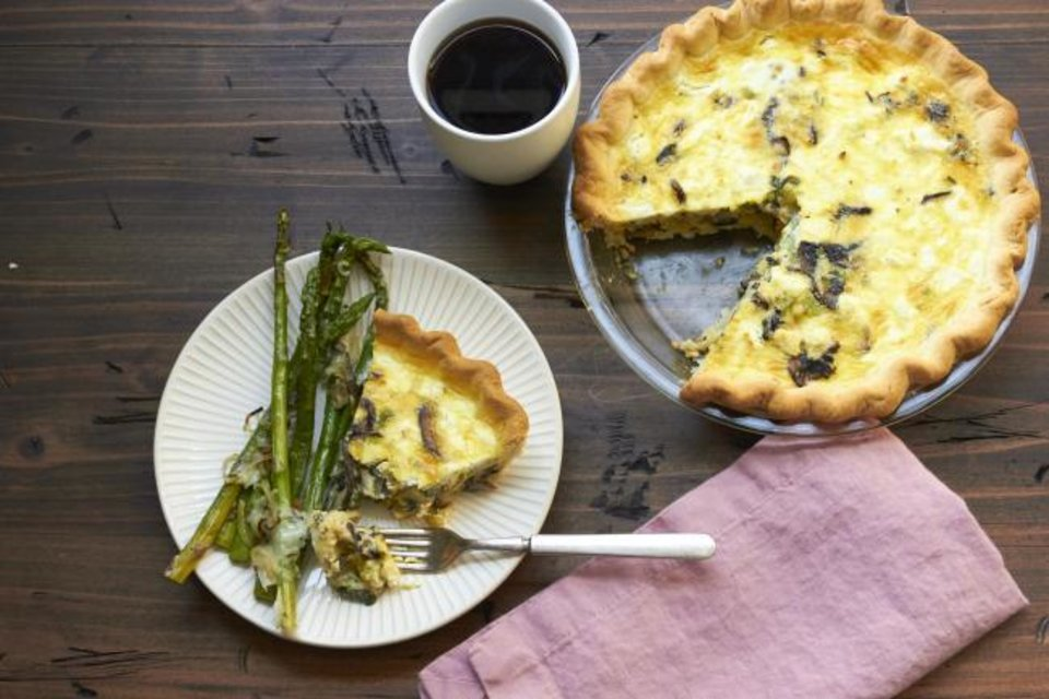 Photo -  Leek, mushroom and goat cheese quiche. Setting up breakfast for your guests to help themselves to when they wake up in the morning is a low-stress, make ahead way for you to offer the morning meal. [Mia/Katie Workman via AP]