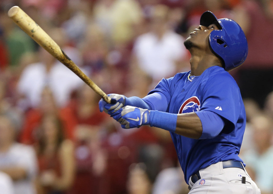 Photo - Chicago Cubs' Jorge Soler hits a pop fly for an out in the fourth inning of a baseball game against the Cincinnati Reds, Wednesday, Aug. 27, 2014, in Cincinnati. Soler was making his major league debut. (AP Photo/Al Behrman)