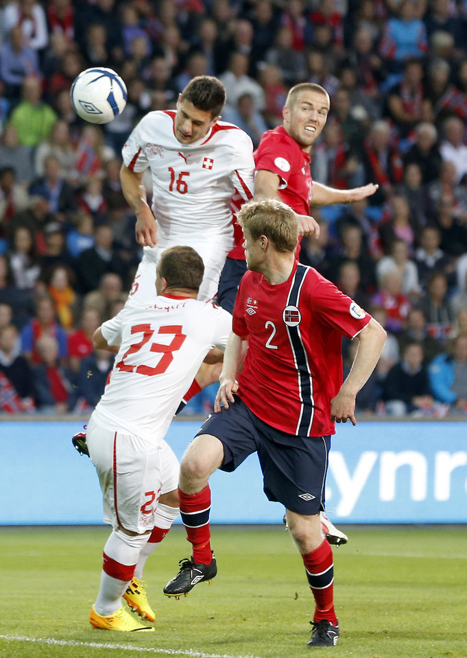 Photo - Switzerland's Fabian Schar, top left, heads the ball to score past Norway's Espen Ruud, top right, during the World Cup group E qualifying soccer match between Norway and Switzerland at the Ullevaal stadium in Oslo, Tuesday, Sept. 10, 2013. (AP Photo/Cornelius Poppe, NTB Scanpix)  NORWAY OUT