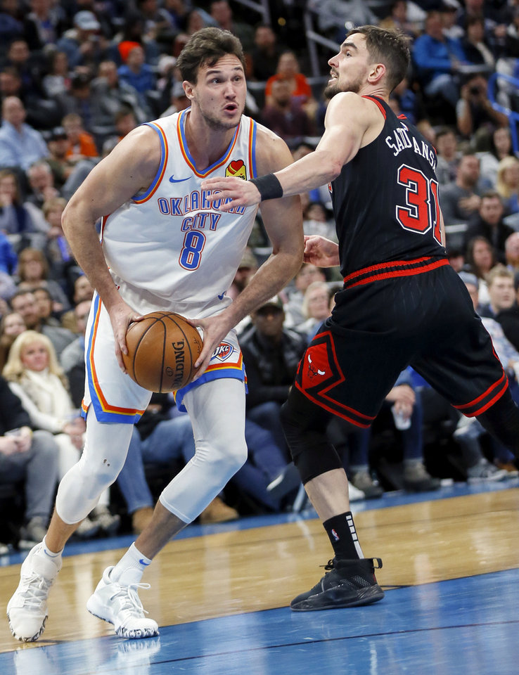 Photo - Oklahoma City's Danilo Gallinari (8) takes the ball to the basket against Chicago's Tomas Satoransky (31) in the second quarter during an NBA basketball game between the Oklahoma City Thunder and Chicago Bulls at Chesapeake Energy Arena in Oklahoma City, Monday, Dec. 16, 2019. [Nate Billings/The Oklahoman]