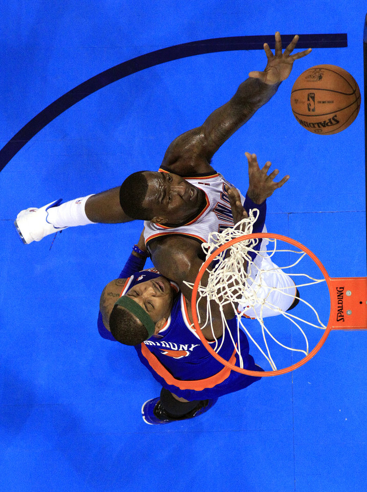 Photo - Oklahoma City's Kendrick Perkins (5) fights New YorK's Carmelo Anthony (7) for a rebound during NBA basketball game between the Oklahoma City Thunder and the New York Knicks at the Chesapeake Energy Arena, Sunday, April 7, 2010, in Oklahoma City. Photo by Sarah Phipps, The Oklahoman
