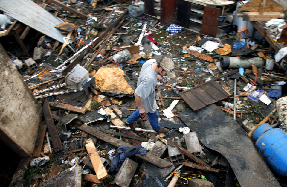 Karl Hurst tries to find anything to salvage among the rubble left behind after a tornado destroyed the home of Tom Chronister north of El Reno, Tuesday, May 24, 2011. Photo by Chris Landsberger, The Oklahoman ORG XMIT: KOD