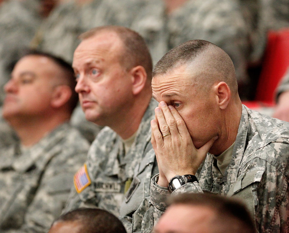LT. Col. Scott Holt of Mannford, OK, far right, and Chief Warrant Officer 3 Greg Kratochwill of Luther, OK, center, listen to speeches at the 45th Infantry Brigade Combat Team deployment ceremony inside the Cox Convention Center,  Wednesday, Feb. 16, 2011.  Photo by Jim Beckel, The Oklahoman