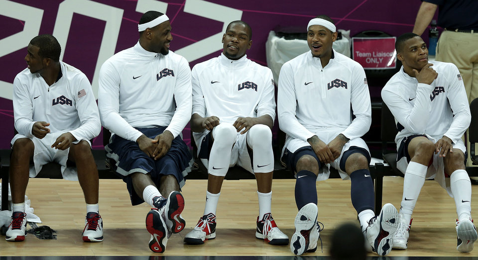 Photo -   United States players from left, Chris Paul, Labron James, Kevin Durant, Carmelo Anthony, and Russell Westbrook sit on the bench during a men's basketball game against Nigeria at the 2012 Summer Olympics, Thursday, Aug. 2, 2012, in London. (AP Photo/Charlie Riedel)