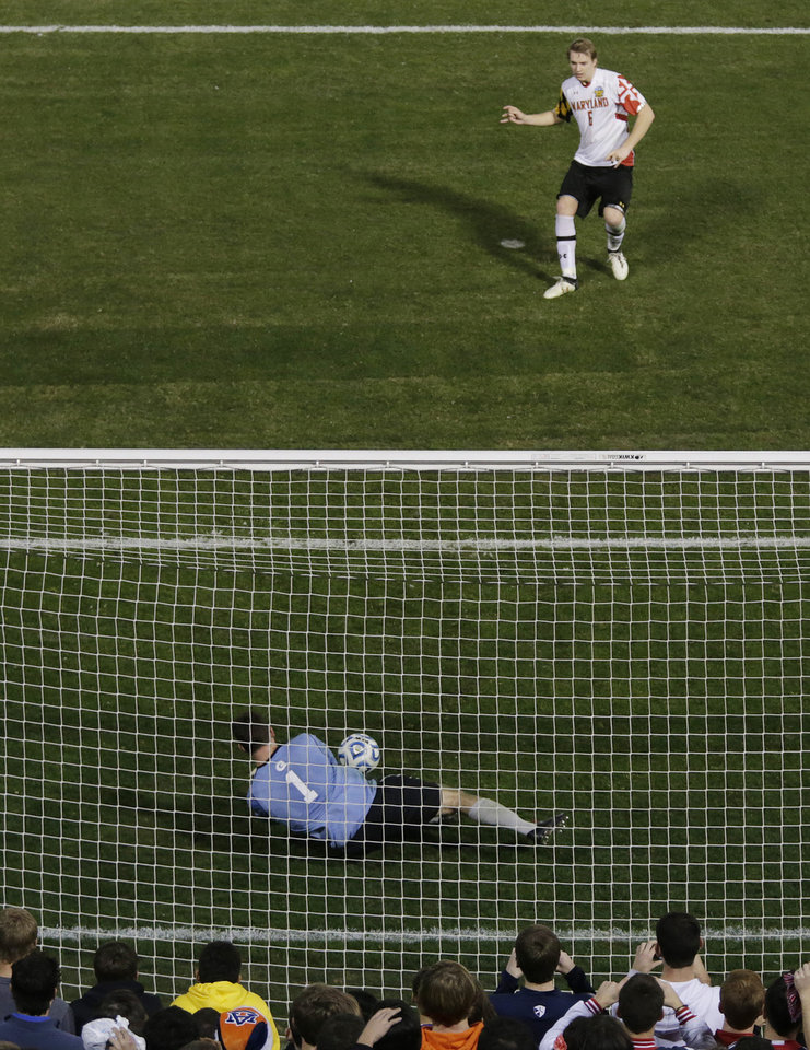 Georgetown goalie Tomas Gomez blocks the penalty shot of Maryland\'s Helge Leikvang (6), giving them a win in their NCAA College Cup men\'s championship semifinal soccer match at Regions Park, Friday, Dec. 7, 2012, in Hoover, Ala. (AP Photo/Dave Martin)