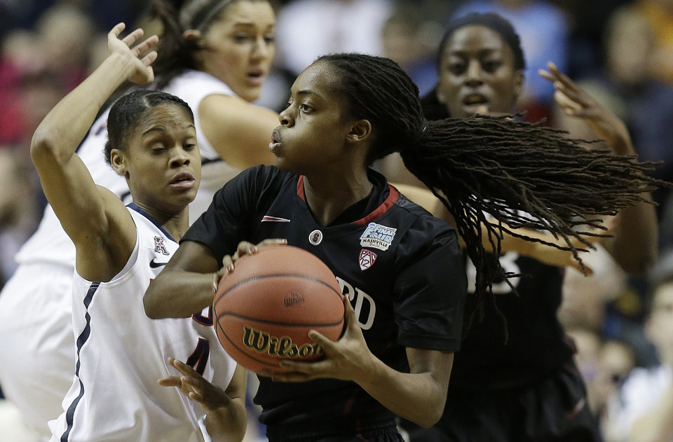 Photo - Connecticut guard Moriah Jefferson (4) defends Stanford guard Lili Thompson (1) during the first half of the semifinal game in the Final Four of the NCAA women's college basketball tournament, Sunday, April 6, 2014, in Nashville, Tenn. (AP Photo/Mark Humphrey)