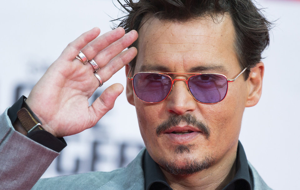 Photo - FILE - In this July 19, 2013 file photo, U.S. actor Johnny Depp arrives for the German premiere of the movie