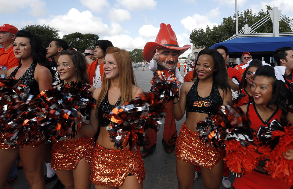 Oklahoma State cheerleaders cheer for the Cowboys during the walk before a college football game between the University of Texas at San Antonio Roadrunners (UTSA) and the Oklahoma State University Cowboys (OSU) at the Alamodome in San Antonio, Saturday, Sept. 7, 2013.  Photo by Sarah Phipps, The Oklahoman
