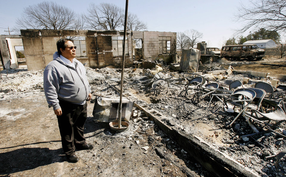 Pastor Darrell Tiger looks at the remains of fellowship hall for the Sallateeska Baptist Church north of Shawnee Wednesday, Feb. 27, 2008. A grass fire burned the church to the ground Monday. BY PAUL B. SOUTHERLAND, THE OKLAHOMAN