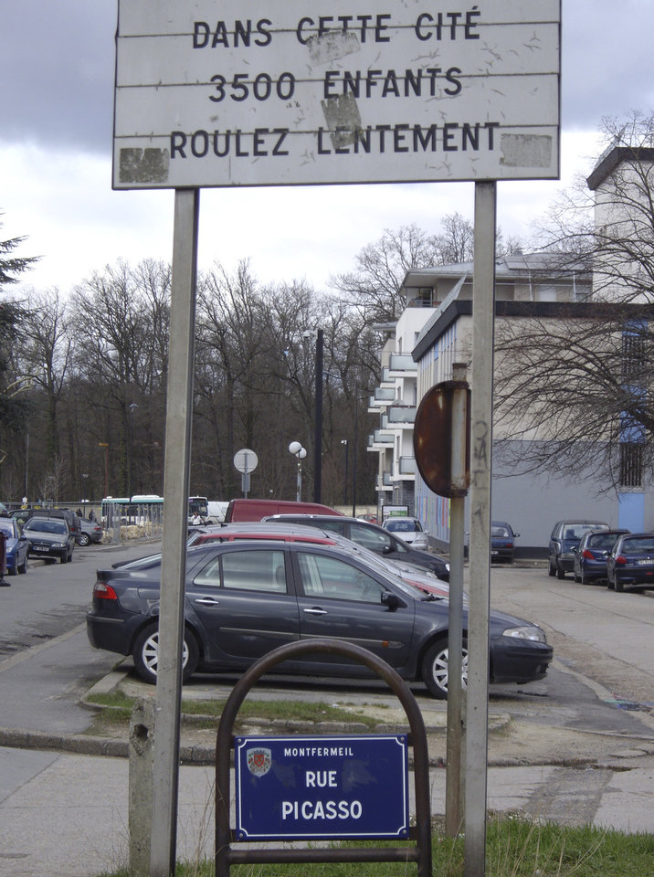 Photo - In this photo taken Feb. 7, 2013, a road sign in the Paris district of Montfermeil reads,