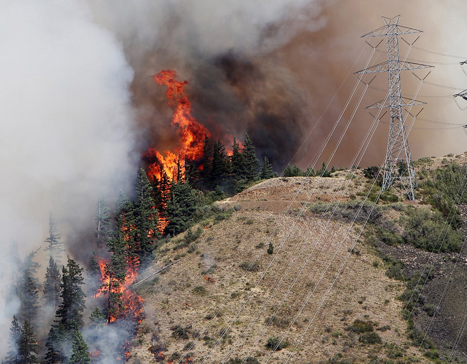 Flames from the Taylor Bridge Fire climb the side of Lookout Mountain east of Cle Elum, Wash., Monday, Aug. 13, 2012. AP photo