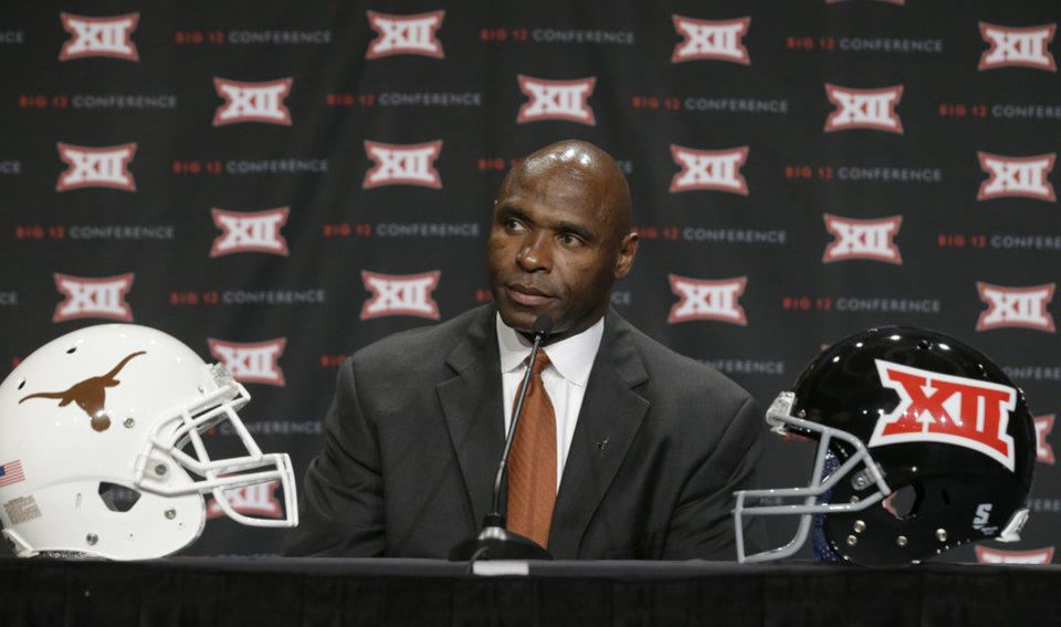 Photo - Texas head coach Charlie Strong listens to a question from a reporter during the Big 12 Conference NCAA college football media days in Dallas, Tuesday, July 22, 2014. (AP Photo)