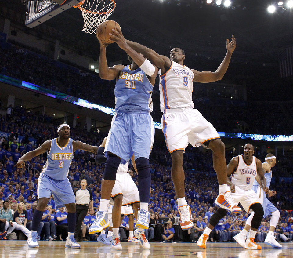 Oklahoma City\'s Serge Ibaka (9) battles for a rebound with Denver\'s Nene (31) during the first round NBA playoff game between the Oklahoma City Thunder and the Denver Nuggets on Sunday, April 17, 2011, in Oklahoma City, Okla. Photo by Chris Landsberger, The Oklahoman