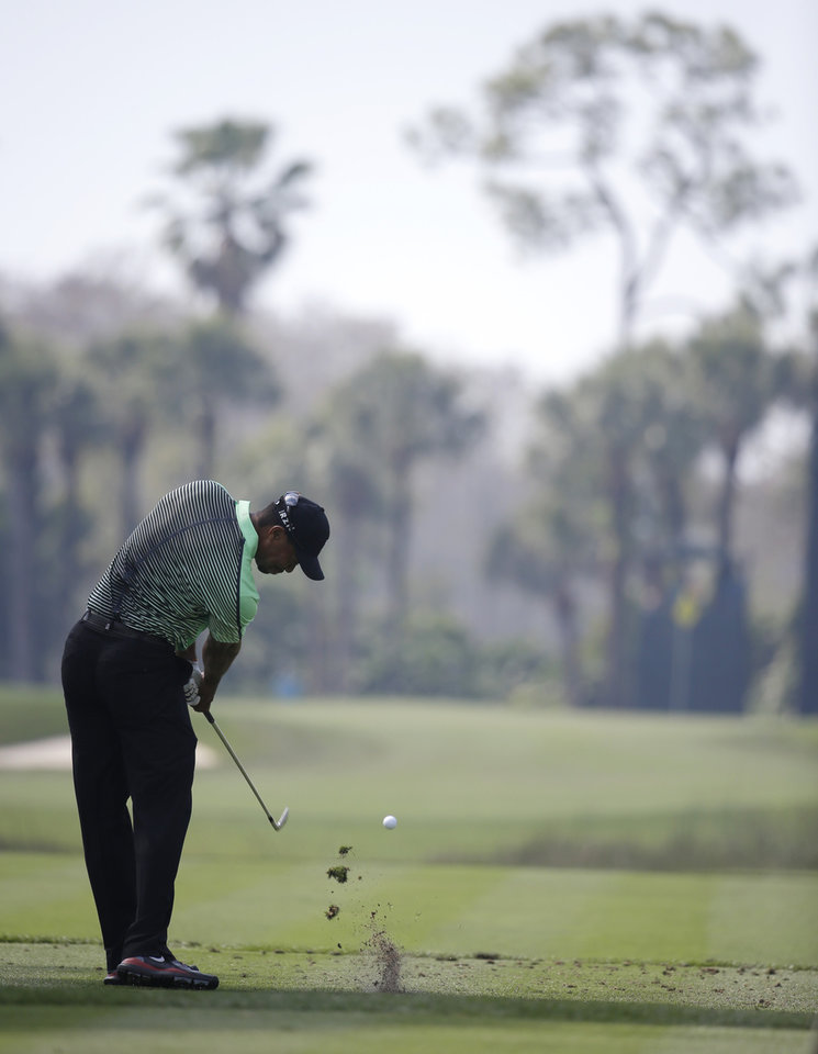 Photo - Tiger Woods tees off on the seventh hole during the second round of the Honda Classic golf tournament, Friday, Feb. 28, 2014, in Palm Beach Gardens, Fla. (AP Photo/Lynne Sladky)