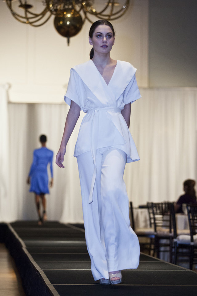 Photo - Model Jessica M. is wearing an ivory suit by Nha Khanh at the Liberte runway show to benefit cystic fibrosis, hosted by Merrill Lynch Wealth Management. Photo provided.