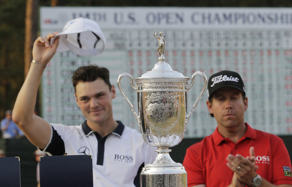 Photo - Martin Kaymer, of Germany, left, and Erik Compton pose with trophy after Kaymer won the U.S. Open golf tournament in Pinehurst, N.C., Sunday, June 15, 2014. (AP Photo/Eric Gay)