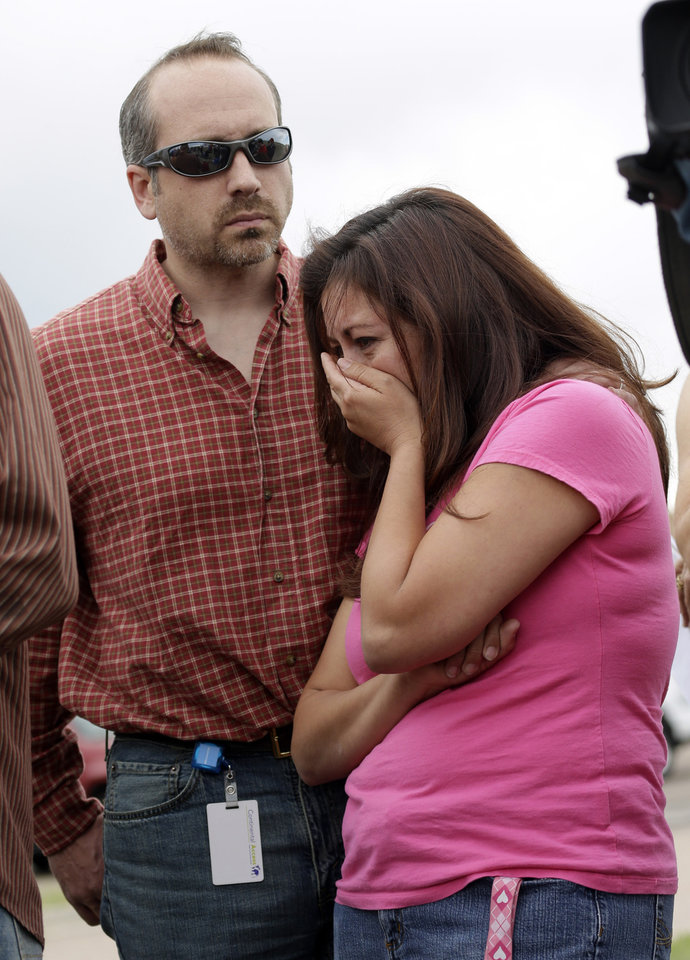 Black Forest resident Bonnie Kruse, right, is hugged by her husband James during a briefing on the progress of the Black Forest Fire in Colorado Springs, Colo., Friday, June 14, 2013. Authorities announced the Black Forest Fire at 30 percent containment on Friday afternoon. Bonnie's family lost five homes to the Black Forest Fire. (AP Photo/Marcio Jose Sanchez)
