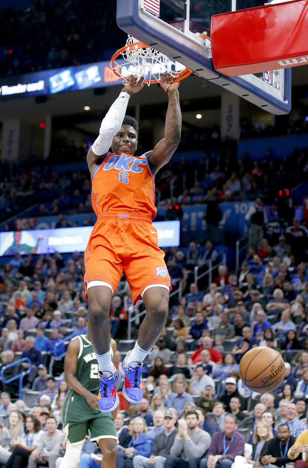 Photo - Oklahoma City's Hamidou Diallo (6) dunks the ball during the NBA game between the Oklahoma City Thunder and the Milwaukee Bucks at Chesapeake Energy Arena,   Sunday, Nov. 10, 2019.  [Sarah Phipps/The Oklahoman]