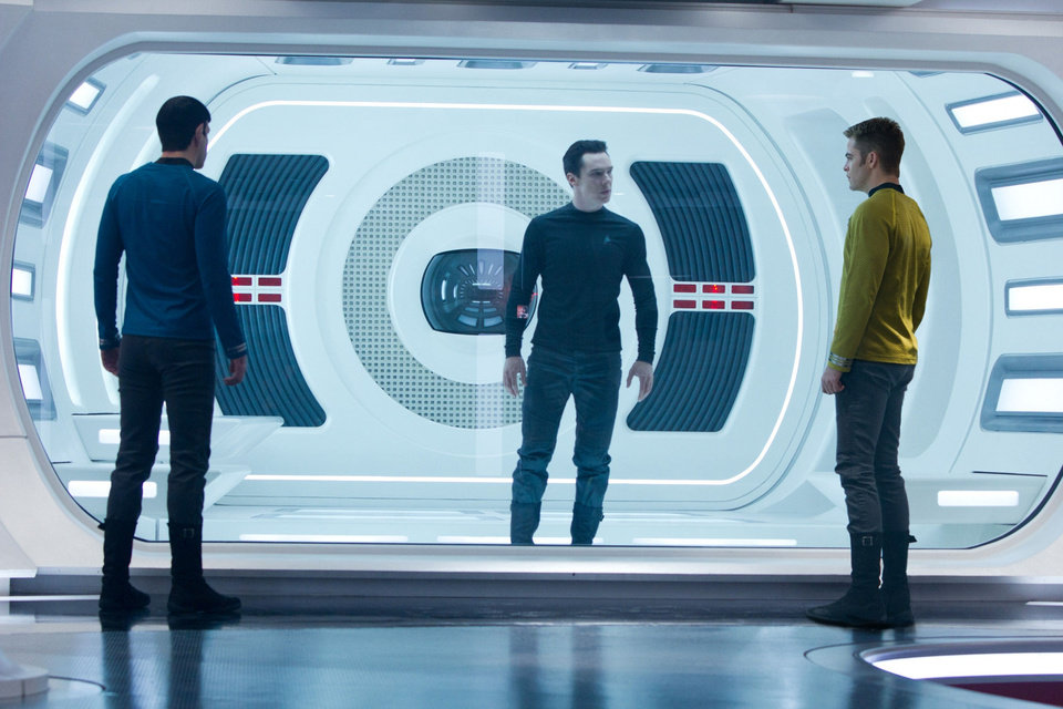 Zachary Quinto as Spock, Benedict Cumberbatch as John Harrison and Chris Pine as James T. Kirk in