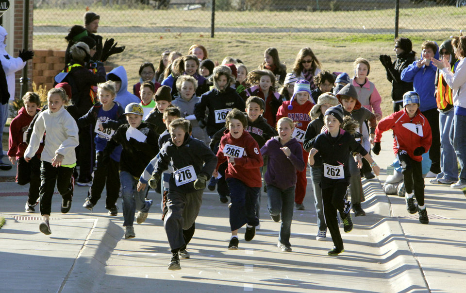 Third-graders from Russell Dougherty Elementary School in Edmond, OK,  take part in a walk-a-thon fundraiser at the City of Edmond's Children's Safety Village, Friday, Nov. 18, 2011. By Paul Hellstern, The Oklahoman