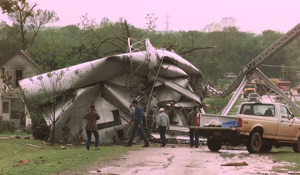 MAY 3, 1999 TORNADO: Tornado damage. Mulhall water tower falls across road.