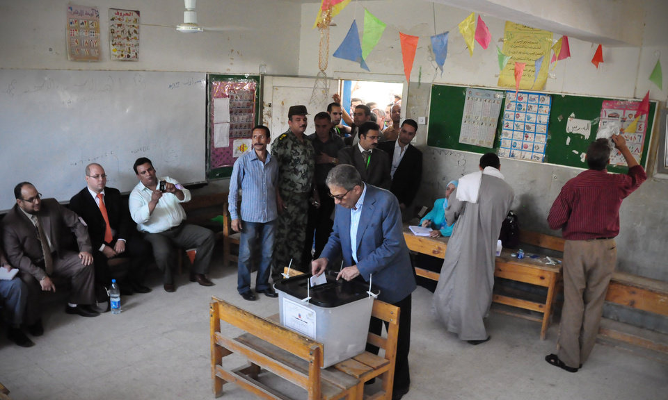 Photo -   In this photo provided by Amr Moussa's Campaign, Egyptian presidential candidate Amr Moussa, casts his vote inside a polling station, in Cairo, Egypt, Wednesday, May 23, 2012. On Wednesday morning, Egypt commenced two days of presidential voting after 16 months of interim rule by the Supreme Council of Armed Forces. This election is the first free and fair race since the ouster of former President Hosni Mubarak. (AP Photo/Ahmed Almekdamy, Amr Moussa Campaign)