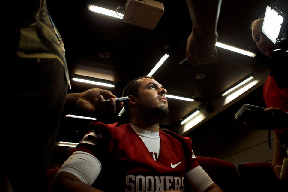 Photo - OU quarterback Landry Jones speaks to the media at the University of Oklahoma's media day in Norman on Saturday, August 6, 2011. Photo by Zach Gray