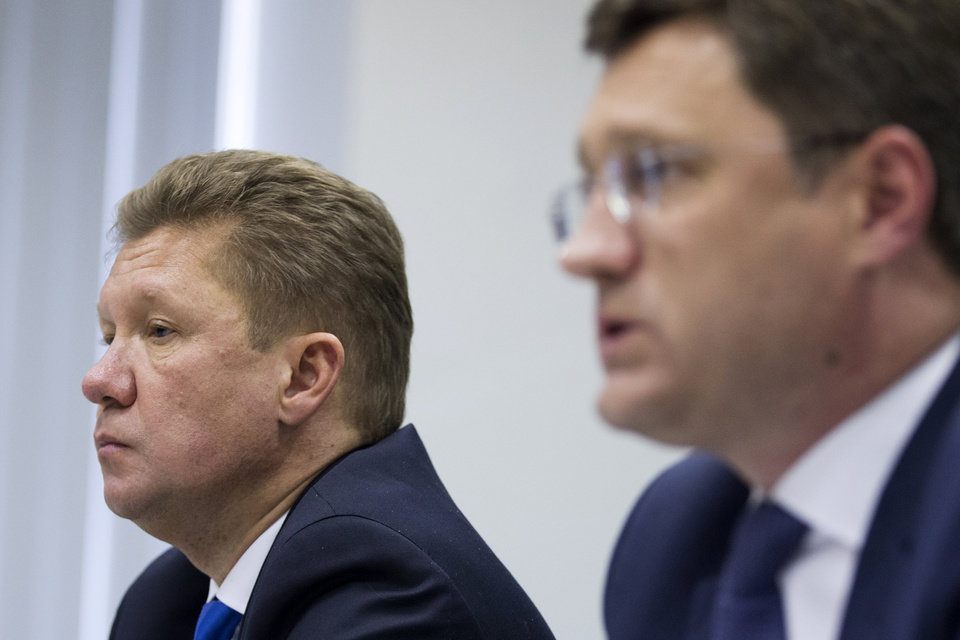 Photo - Russia's Energy Minister Alexander Novak, right, speaks, as Russian state-run natural giant Gazprom CEO Alexei Miller listens at a news conference in Moscow, Russia, Monday, June 16, 2014.  Russia on Monday cut gas supplies to Ukraine as a payment deadline passed and negotiators failed to reach a deal on gas prices and unpaid bills amid continued fighting in eastern Ukraine. The decision does not immediately affect the gas flow to Europe, but could disrupt the long-term energy supply to the region if the issue is not resolved, analysts said. (AP Photo/Pavel Golovkin)