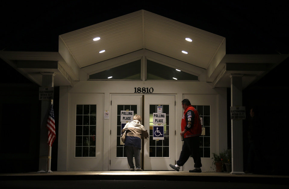 Photo -   Voters walk into their polling place, Star Bridge Christian Center, to cast their ballots in the general election before sunrise Tuesday, Nov. 6, 2012, in Wildwood, Mo. (AP Photo/Jeff Roberson)